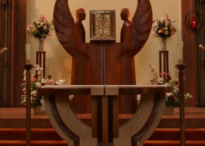 ST. JOSEPH'S CATHOLIC CHURCH Crescent City, California - The wingspan of the angels ia a perfect reflection of the round topped altar in dimension. This is hand carved in Honduras mahogany.