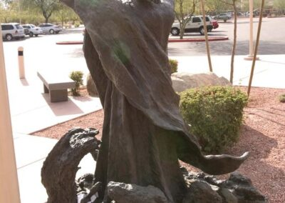 ST. PATRICK CATHOLIC COMMUNITY Scottsdale, Arizona - Jude's arms are in praise and joy reminding us of how the scriptures tell us to consider it all joy when we suffer difficulties. The medallion of Jesus is around St. Jude's neck as is traditional to statues of St. Jude.