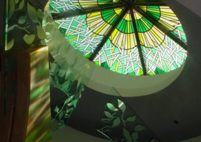 ST. PATRICK CATHOLIC COMMUNITY Scottsdale, Arizona - The greens of the stained glass skylight, the color of regular time in the church calendar, reflect on the etched leaves (the life of the church.)